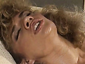 Curly haired vintage lesbian Amber Lynn eats blondie's soaking pussy