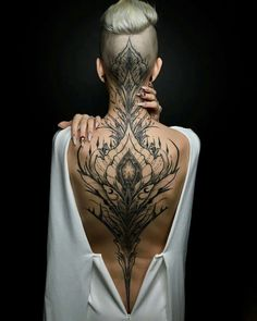 Enjoy body art brilliance with awesome back tattoos for men and women that are masterpieces. The back is one of the most spacious areas for tattoos on the body. If you are looking for the best full-back tattoo idea then this collection is for you. Head Tattoos, Body Art Tattoos, Tatoos, Tattoo Neck, Trible Tattoos, Tattoo Down Spine, Nape Tattoo, Chest Piece Tattoos, Chicano Tattoos