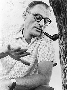 Arthur Miller, half-length portrait, facing right, with pipe in his mouth.