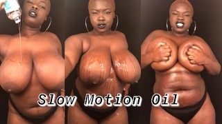 Slow motion BBW rubbing oil on big natural tits & body