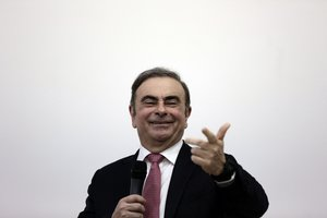 Nissan's former chairman Carlos Ghosn, smiles at a press conference in Beirut, Lebanon, Wednesday, Jan. 8, 2020.