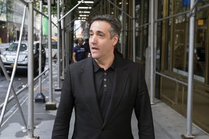 In this May 4, 2019 file photo, Michael Cohen, President Donald Trump's former personal attorney, stops to talk to a member of the media in New York. President Donald Trump's ex-personal lawyer, Michael Cohen, has lost a round in his long-shot bid to get the Trump Organization to cover all of his legal costs.