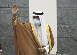 The new Emir of Kuwait Sheikh Nawaf Al Ahmad Al Sabah, waves after he performed the constitutional oath at the Kuwaiti National Assembly in Kuwait, Wednesday, Sept. 30, 2020.