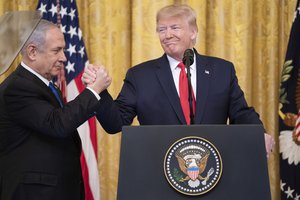 President Donald Trump delivers remarks with Israeli Prime Minister Benjamin Netanyahu Tuesday, Jan. 28, 2020, in the East Room of the White House to unveil details of the Trump administration's Middle East Peace Plan.