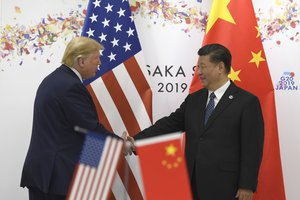 President Donald Trump shakes hands with Chinese President Xi Jinping during a meeting on the sidelines of the G-20 summit in Osaka, Japan, Saturday, June 29, 2019