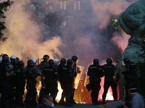 Serbian riot police clashes with protesters in Belgrade, Serbia, Wednesday, July 8, 2020.