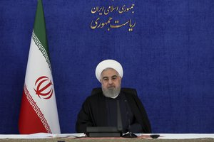 In this photo released by the official website of the office of the Iranian Presidency, Iranian President Hassan Rouhani attends a meeting of his government's coronavirus taskforce in Tehran, Iran, Saturday, Nov. 28, 2020. Rouhani vowed Saturday to exact revenge over the killing of Mohsen Fakhrizadeh, a scientist linked to Tehran's disbanded military nuclear program as he joined other officials in blaming Israel for the slaying.