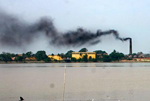 File - A factory on the river Hooghly in the industrial town of Rishra, India, spews black smoke from a chimney. More than 5 million people die annually from air pollution, with the majority of deaths in China and India.