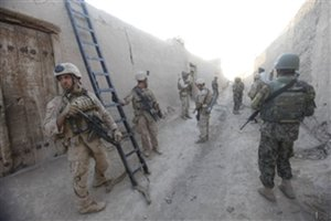 File - U.S. Marines with 3rd Platoon, Bravo Company, 2nd Reconnaissance Battalion, 2nd Marine Division and Afghan National Army soldiers prepare to clear a compound during a city sweep of Sar Buzeh, Nimroz province, Afghanistan, on March 29, 2011.