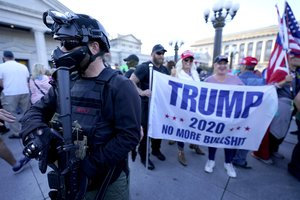 Supporters of President Donald Trump demonstrate outside the Pennsylvania State Capitol, Saturday, Nov. 7, 2020, in Harrisburg, Pa., after Democrat Joe Biden defeated Trump to become 46th president of the United States.