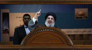 File - Hezbollah leader Sheik Hassan Nasrallah speaks during a rally to mark Jerusalem day or Al-Quds day, in a southern suburb of Beirut, Lebanon, Friday, Aug. 2, 2013.