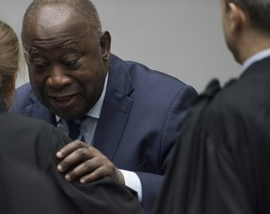 Laurent Gbagbo enters the courtroom of the International Criminal Court  in The Hague, Netherlands