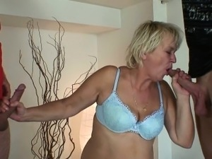 Cleaning woman gets her old pussy filled with two cocks