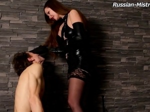 Skinny guy getting punished by the chick in leather clothes